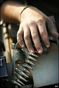 Israeli soldier leans on a magazine of bullets near Kibbutz Mefalsim, close to Gaza
