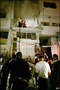 Palestinians inspect rubble after Sunday night Israeli air attack on Gaza City