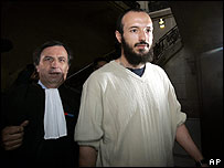 Redouane Khalid, one of the suspects, arrives at the court with his lawyer