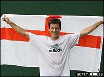 Tim Henman holds an England flag