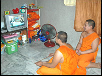 Phra Prawit (r) and Phra Phitak (l) watching TV