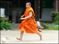 A Buddhist monk playing football