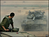 Israeli armoured vehicles drive towards the Gaza Strip