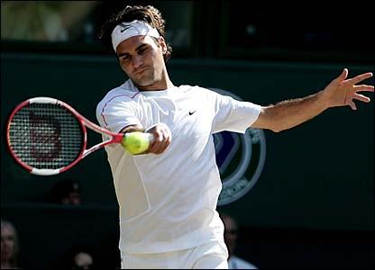 Roger Federer hits a forehand winner