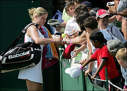 Kim Clijsters signs autographs after advancing into the last eight