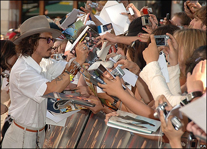 Johnny Depp signs autographs