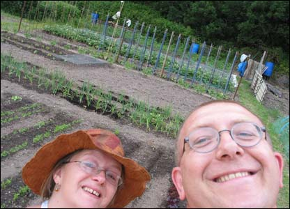 Ade Morris and his girlfriend Nadine posing in front of their allotment at Llanishen in Cardiff