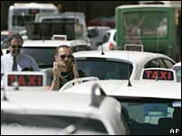 A striking taxi driver in central Rome on 3 July