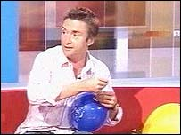 Richard Hammond attempts to insert a skewer into a balloon