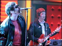 Liam (L) and Noel Gallagher of Oasis