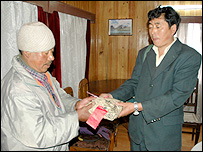 Indian postman Mr Thaman exchanges mail with his Chinese counterpart Ye Ling
