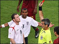 Wayne Rooney is shown the red card by referee Horacio Elizondo