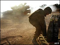 An Israeli soldier reloads a mobile artillery unit on the northern border of the Gaza Strip