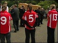 Members of Jonathan McDonald's GAA club forming a guard of honour