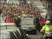 Mourners following Anita's funeral cortege