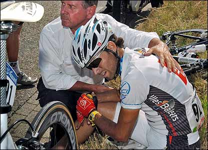 Alejandro Valverde is comforted after crashing during stage three