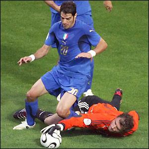 Germany goalkeeper Jens Lehmann saves at the feet of Simone Perrotta
