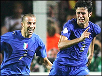 Grosso celebrates, with Del Piero, scoring Italy's first goal