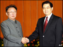 Kim Jong-il (left) shakes hands with Chinese President Hu Jintao during a visit to Beijing in January 2006
