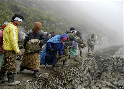Labourers work on a damaged portion of Nathu La Road, about 11 kilometres (7 miles) from the India-China border outpost in Nathu La Pass