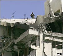 Palestinian guard stationed on roof of bombed interior ministry