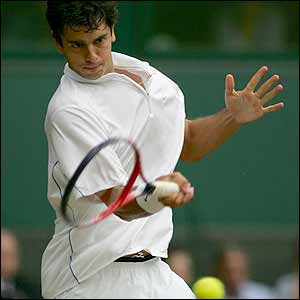 Ancic powers a forehand back to Federer