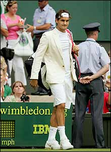 Roger Federer enters Centre Court