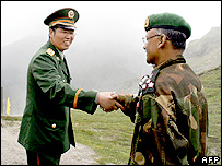 Chinese and Indian military officials exchange greetings at the Nathu La pass
