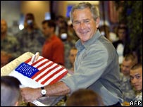 President Bush with his Stars and Stripes birthday cake