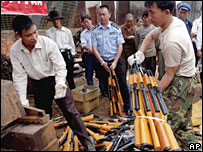 Chinese police prepare to destroy imitation guns in Kunming in China's Yunnan province