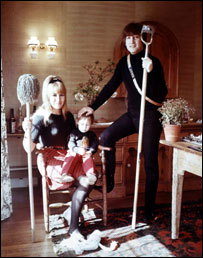 The Lennon Family (Cynthia Lennon; Julian Lennon; John Lennon) by Robert Whitaker, 1965