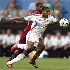 Portugal right-back Miguel and France's Florent Malouda