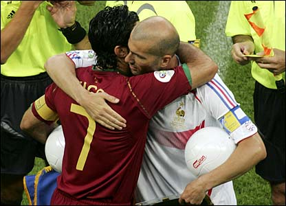 Opposing captains Luis Figo and Zinedine Zidane embrace