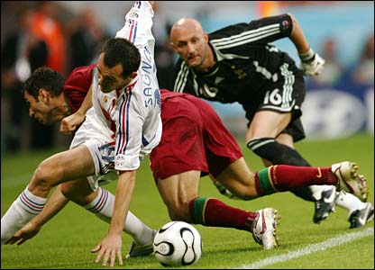 France's Fabien Barthez's scrambles along his goal line