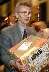 File photo of George Duboeuf delivering a case of Beaujolais Nouveau to New York's  Waldorf Astoria Hotel in 1999