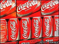 Coca-Cola cans on sale in a shop