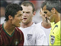 Cristiano Ronaldo, Wayne Rooney and referee Horacio Elizondo