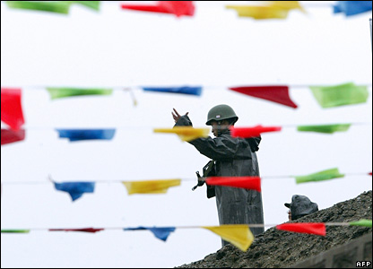 A Chinese soldier gestures during a ceremony marking the re-opening of the China-India border at the Nathu La Pa