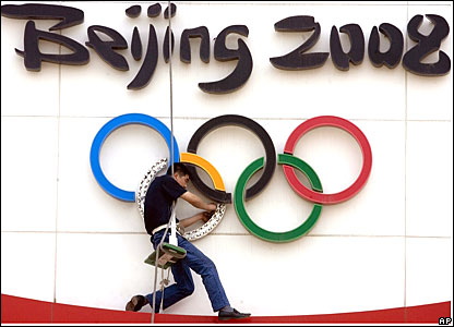 A man works on the Olympic clock