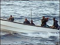 Armed pirates in the sea off Somalia