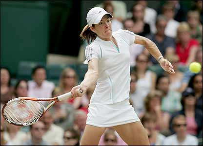 Henin-Hardenne powers a forehand return back to Clijsters