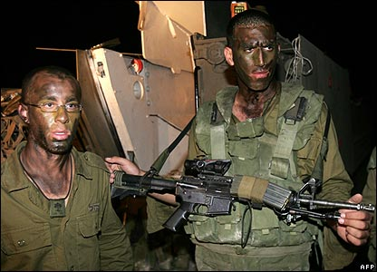 Israeli infantry soldiers prepare to enter the Gaza Strip from the Kibbutz of Zikim