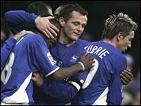 Jim Magilton celebrates with team-mates