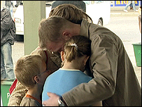 A Polish family says goodbye to their father before he leaves for England