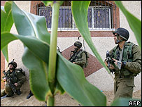 Israeli troops take over a Palestinian house