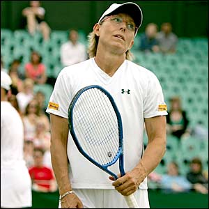 Navratilova looks to the sky ruefully during her final appearance at Wimbledon