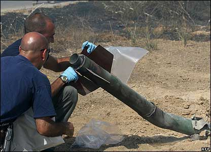 Israeli sappers check the remains of a shell fired from the Gaza Strip into the Israeli city of Ashkelon