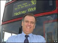 George Psaradakis next to a bus