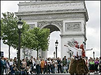 Dancers perform in front of the Arc de Triomphe in Paris