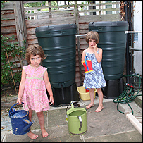 Justin's daughters in front of the Rowlatt's water butts